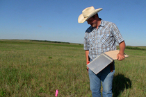 With detailed notes and pictures, Ben catalogs the vegetation at each site. The information will be used to determine the prairie chicken's preferred habitat, a potential resource for private landowners who hope to manage for and attract the native bird to their land.