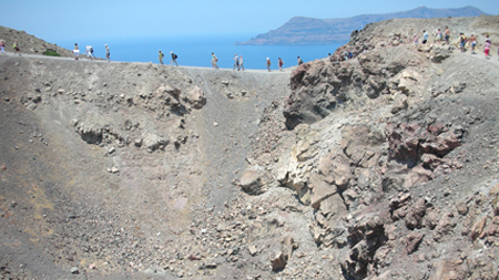 Treking along the Nea kameni volcano in Santorini-Greece