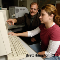 Dan Snow and undergraduate student Megan Larsen discuss methods for analysis of algal toxins in lake water.