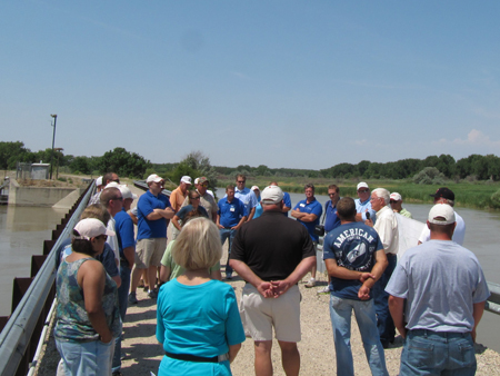 � Water Leaders Academy participants listen to  John Lawson, US Bureau of Reclamation (retired), describe the Whalen Diversion Dam on the Platte River